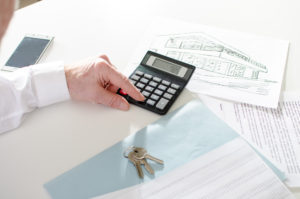 Realtor analyzing financial planning of a house at office